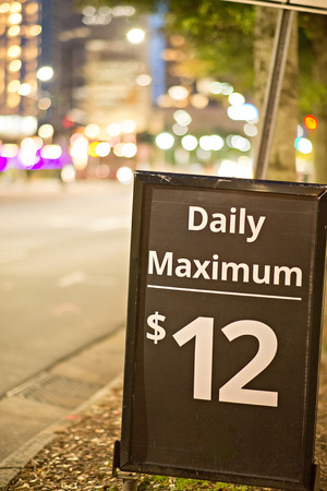 expiring: daily and hourly parking sign in the city Stock Photo
