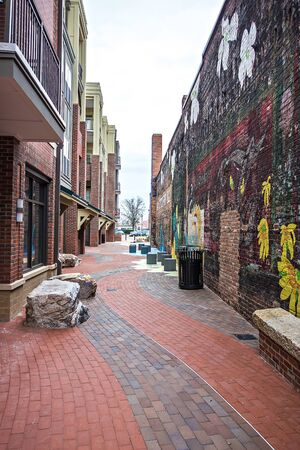 ortseingangsschild: old brick alley in old town during day