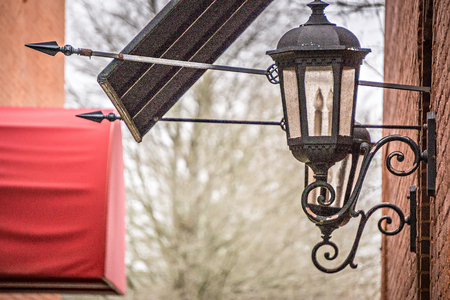 street lamp: historic old town alley entrance Stock Photo