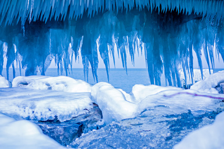 mi: icicle formations at the pier on lake michigan