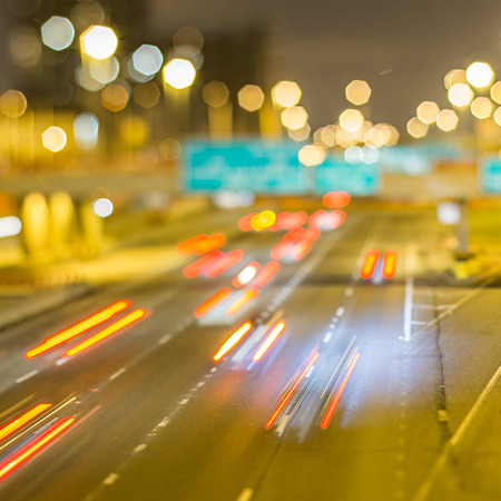 Cars on freeway at night Stock Photo