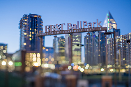ballpark: April 2017 Charlotte NC USA - BB&T baseball park sign and charlotte skyline with tilt effect in the morning Editorial