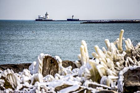 frozen lake: lighthouses and buoys on coast near cleveland ohio lake erie