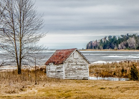 ald abandoned buildings overlooking lake michigan