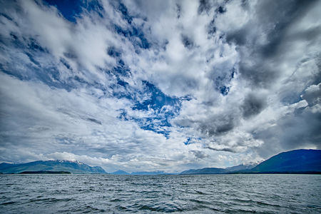 frontier: alaska waterscape and mountains near favorite channel and  juneau alaska Stock Photo