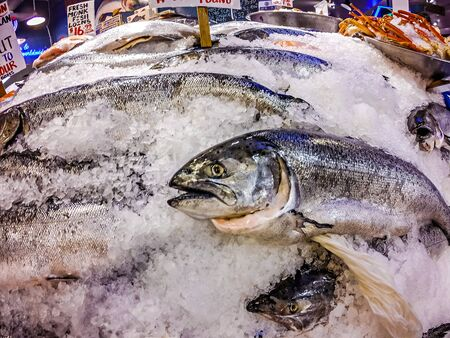 Fresh fish on ice for sale at Pike Place Market in Seattle Stock Photo