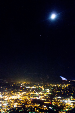 flying at night over cities below Banco de Imagens - 85944721