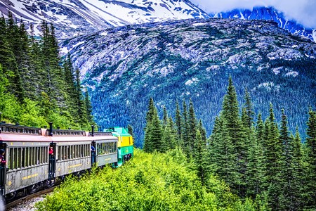 SKAGWAY, ALASKA, USA - JUNE 2017 - Alaskan Canadian White Pass train ride attraction through british columbia canadian rocky mountains Sajtókép