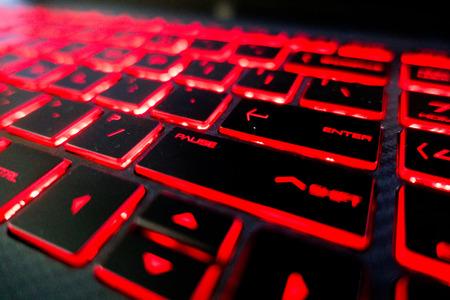 red lights keyboard keys on black keyboard