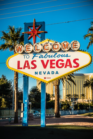Las Vegas welcome Sign with Vegas Strip in background