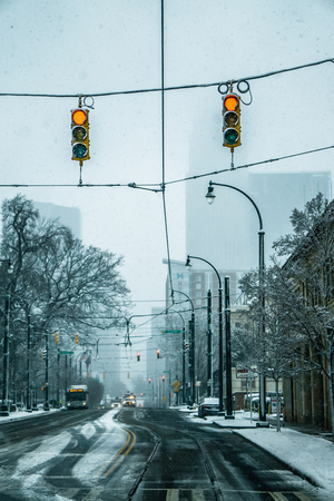 rare wintry mix around charlotte city streets in north carolina Stock Photo