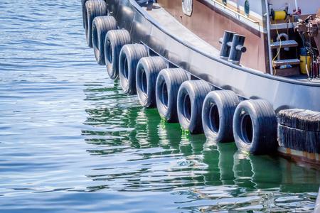 small tug boat parked at pier in ketchikan alaska
