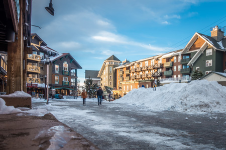 snowshoe mountain village and restaurants and shops on a sunny day