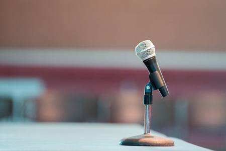 announcer microphone on table before boxing ring Stock Photo