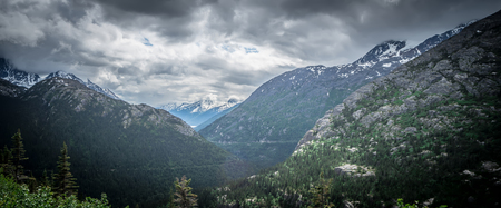 The White Pass and Yukon Route on train passing through vast landscape Reklamní fotografie