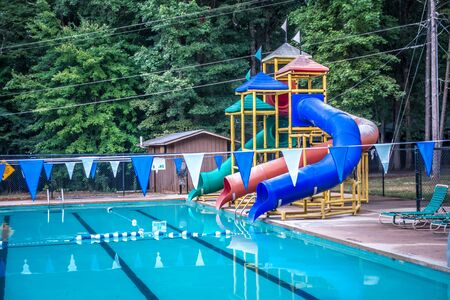 family fun at an outdoor pool Stock Photo