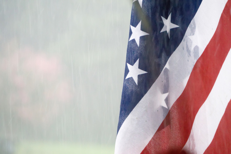 american usa flag with rainy weather