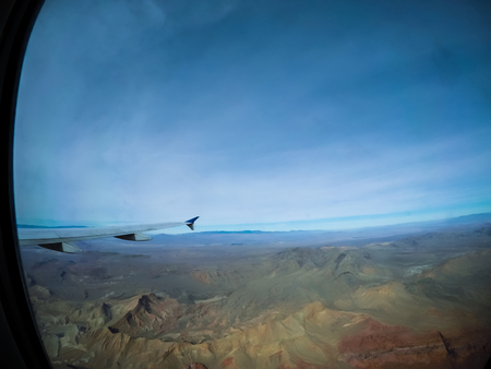 in an airplane flying over valley of fire near las vegas