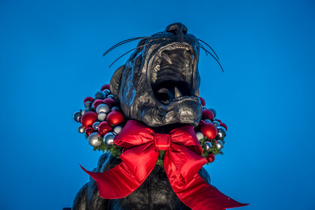 black panther statue decorated in christmas wreath in charlotte north carolina