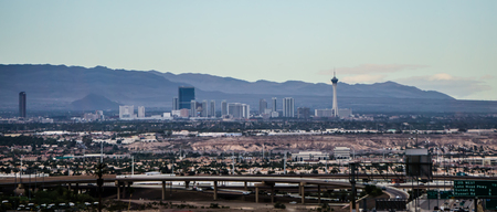 Las vegas city surrounded by red rock mountains and valley of fire