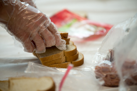 students of coworkers making food for charity or homeless people
