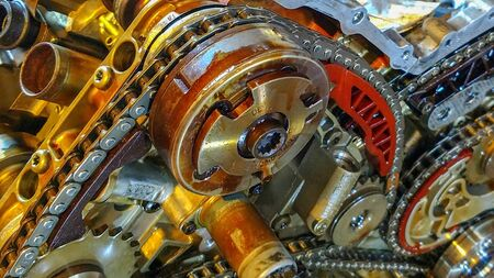 shown large car engine with exposed timing chains