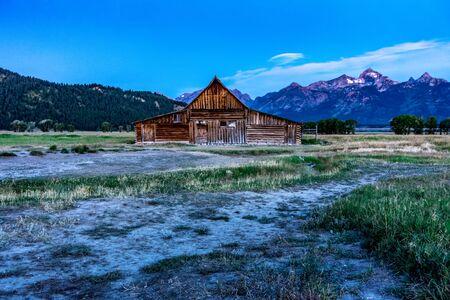 Grand Teton scenic view with abandoned barn on Mormon Row Stock Photo
