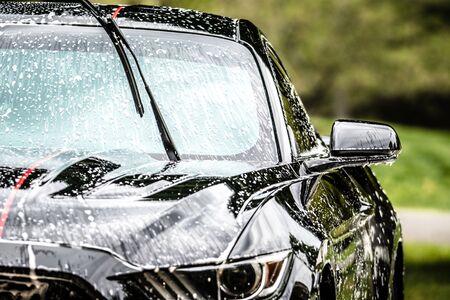 washing car with foam in summer