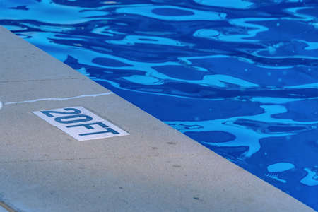20 foot label by edge of pool