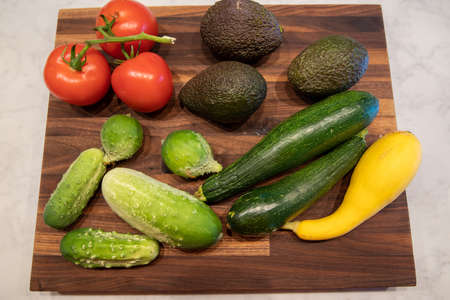 vegetables on butcher block cutting board