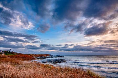 Sunset in newport rhode island at castle hill lighthouse 版權商用圖片