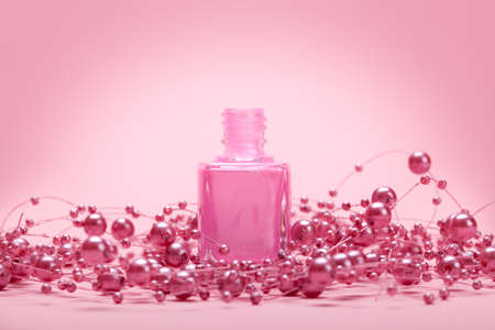 Nail polish on pink background