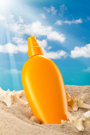 Summer sunbath - suntan oil Stock Photo - 10472556