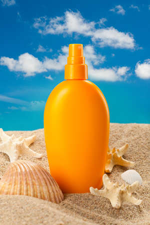 sunscreen: Suntan oil on blue sky background