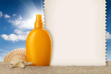 Summer background - suntan oil, shell and blank card photo