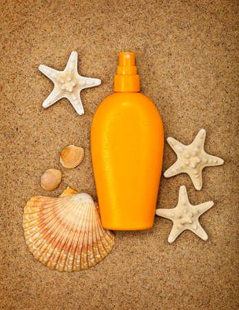 Summer beach - suntan oil photo