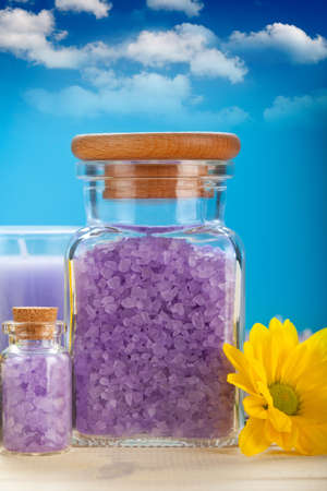Lavender bath salt on blue sky background photo