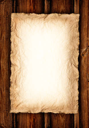 Background - Old crumpled paper on wood  photo