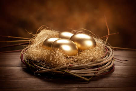nest egg: Golden easter eggs  Stock Photo