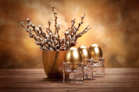 Three golden eggs and blossom tree photo