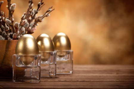 Easter - Golden eggs on brown background photo