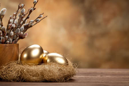 easter decorations: Easter - Golden eggs in the nest
