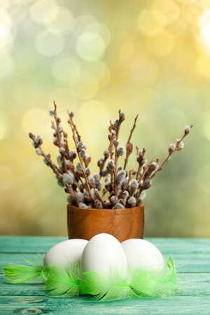 Three white eggs and catkin Stock Photo