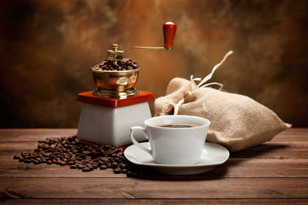 Coffee cup and grinder Stock Photo