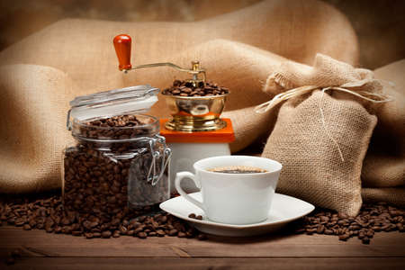 Jar of coffee and coffee cup photo