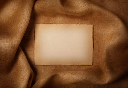 Background - old paper sheet on jute background Stock Photo