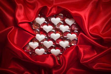 Valentine background - white hearts on red satin photo