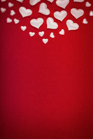 White hearts on red background  photo