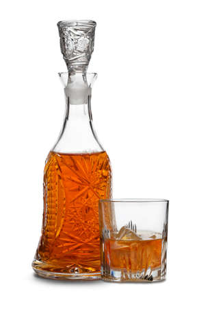 Whisky decanter and drink with ice photo