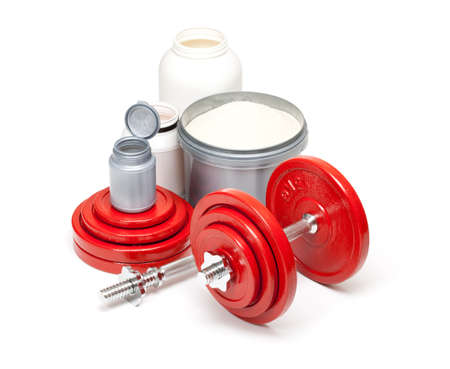 Dumbbells and supplements for body building photo